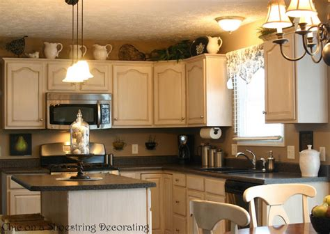 Glazing Kitchen Cabinets Before And After Chic On A Shoestring Decorating Kitchen Before And After Featuring Glazed Antiqued Cabinets