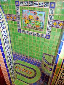 bathroom shower using mexican tiles by kristiblackdesigns