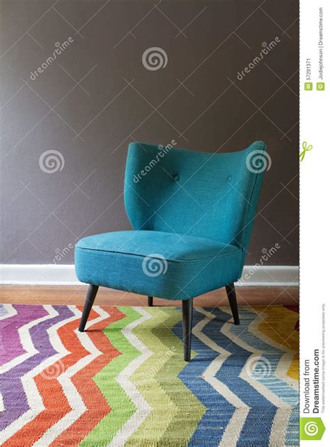 Teal Patterned Armchair Single Teal Blue Armchair And Colorful Chevron Pattern Rug