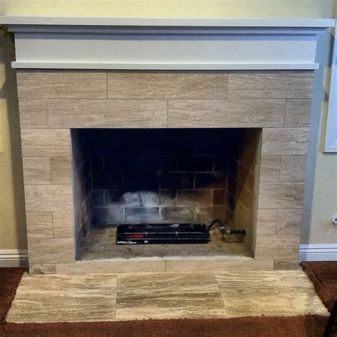 custom fireplace mantle and travertine tile yelp