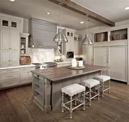 grey kitchen cabinets with wood countertop in