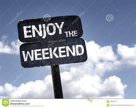 the weekend images enjoy the weekend sign with clouds and sky background
