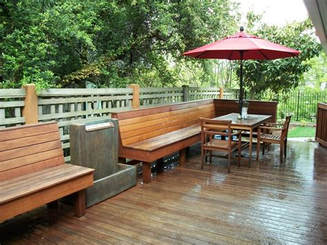 built in deck bench an ironwood deck with built in benches and a splash or