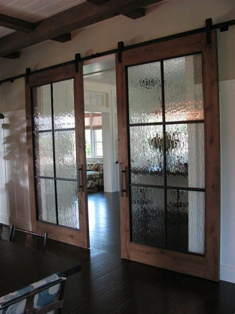sliding barn doors with windows barn doors with seeded glass panels home beautification track door glass barn