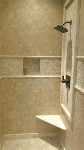 Extra large vertical subway with glass mosaic shower niche travertine