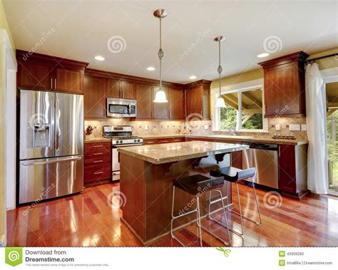 kitchen room photo shiny kitchen room with granite tops and steel appliances stock photo image 43909280