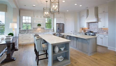 kitchens with 2 islands white kitchen with stainless steel trim