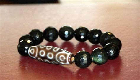 2 eyed dzi bead meaning gentle creation 21 eye dzi bead obsidian
