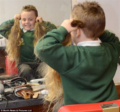five year old gets haircut for first time rean carter rean carter has had his first hair cut five years after