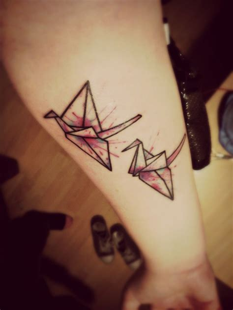 paper effect tattoo origami crane tattoo with splattered colour effect