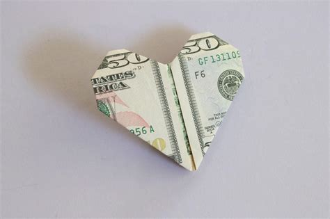 Step By Step Money Origami - how to fold a dollar bill into an origami hgtv