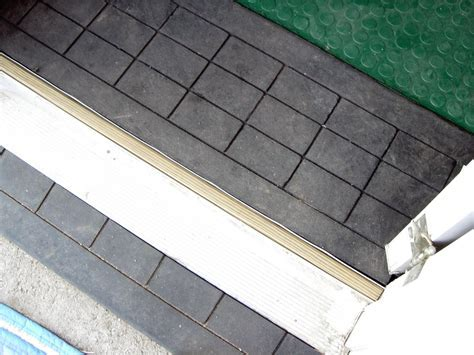 How to Install Rubber Flooring and a Threshold Ramp   how