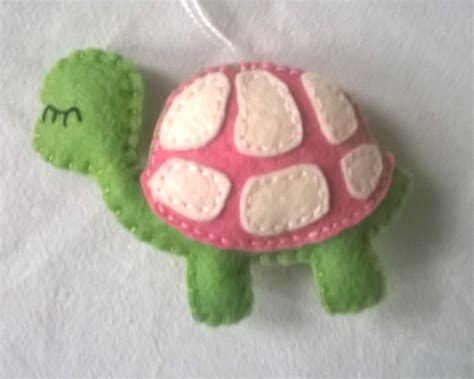 felt turtle ornament with white and pink grab a coffee