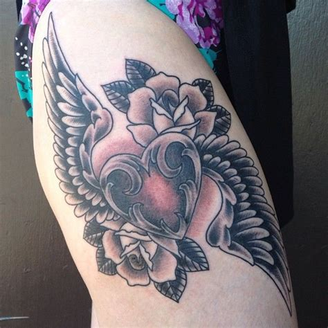 mid pacific tattoo black gray wings roses thigh by matt at
