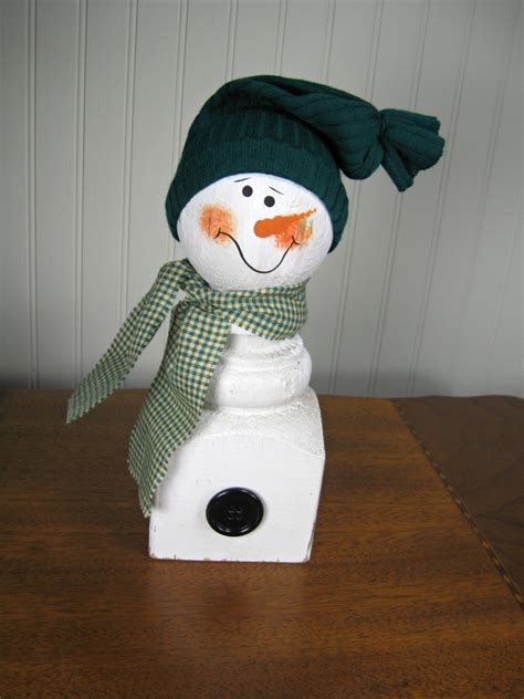 sock hat for snowman reclaimed wood porch post snowman with sock hat