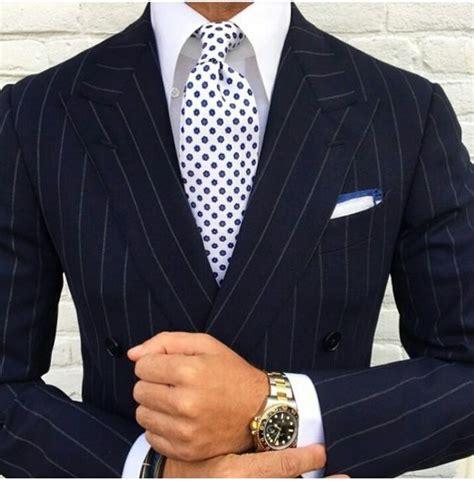 blue suit patterned shirt black patterned suit whte shirt and polka dot tie mens