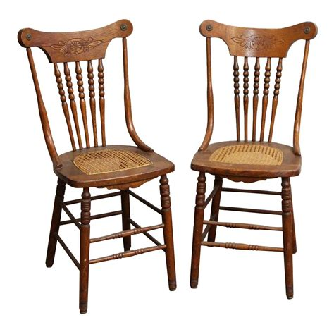 carved wood chair antique pair of carved wood chairs with wicker seat olde things
