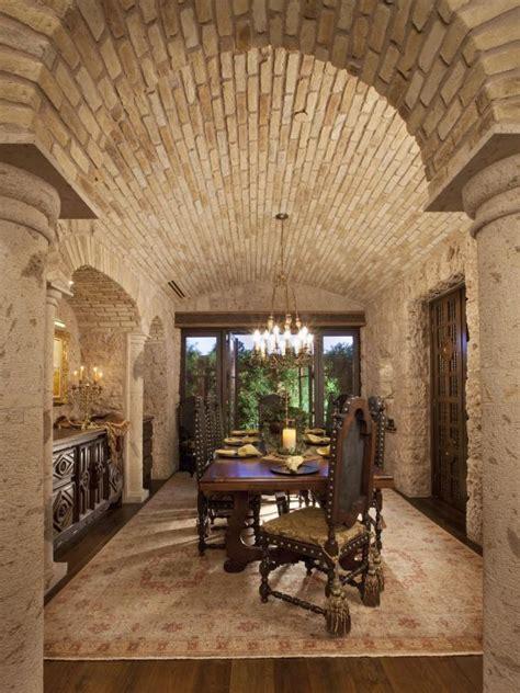 brick barrel ceiling  mediterranean inspired dining room