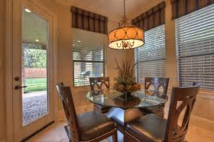 Dining room traditional design ideas with beige blinds breakfast table