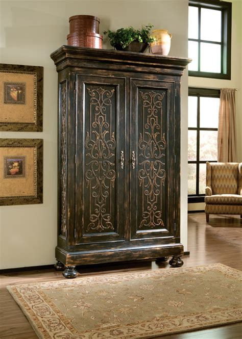 Armoire In Living Room scrolling gate armoire mediterranean living room
