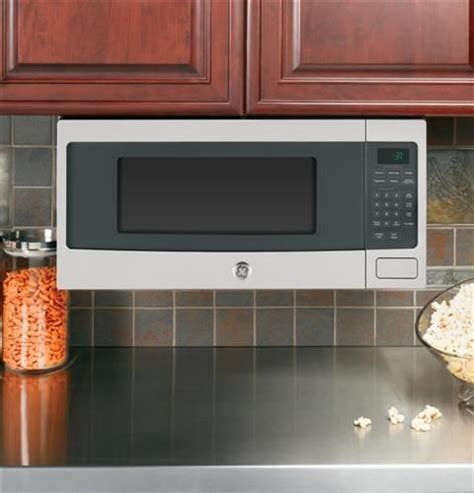 GE Profile space saver cabinet depth microwave, with