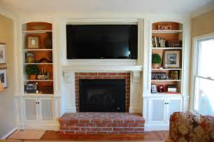 tv fireplace ideas custom mantel tv cabinetry