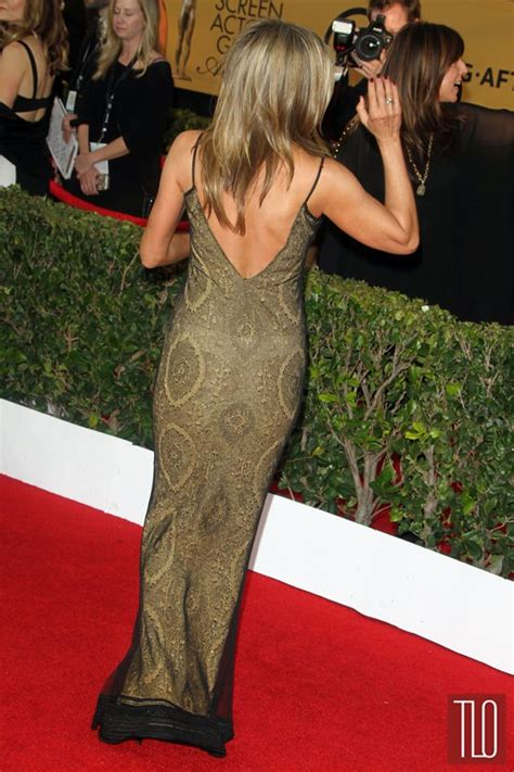 Jlos Armload Of Bangles Are So Sexyso She Wears Em A Lot by Aniston In Vintage Galliano At The 2015