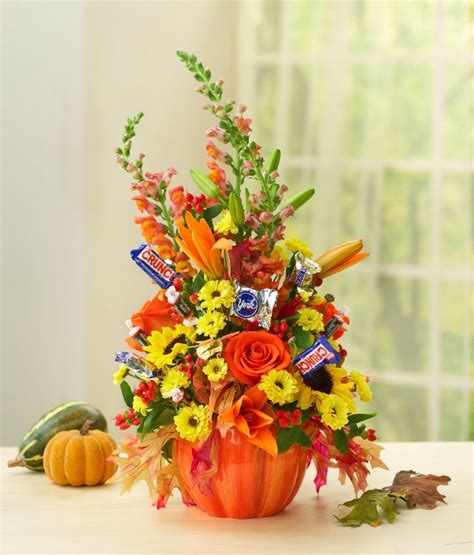 Easy Halloween Decorations To Make At Home diy halloween flower arrangement with candy petal talk
