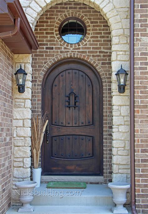 Arched Doors Exterior Rustic Exterior Doors Arched Top In Knotty Alder Wood With Speakeasy And Wrought Iron