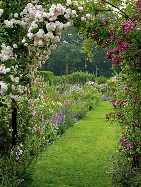Garden Arbor Path Arbor With Flowers Garden Path Beyond