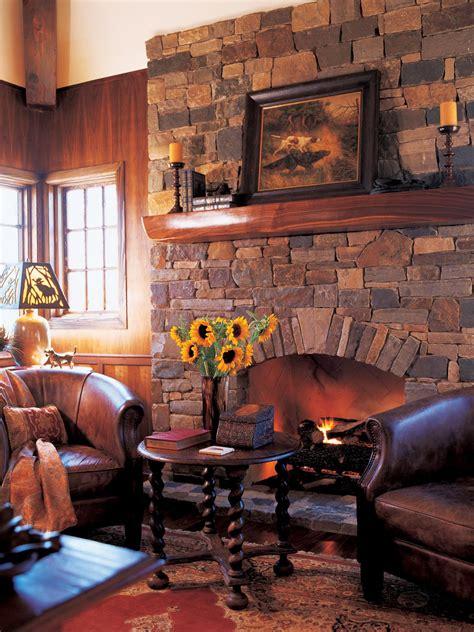 rustic sitting room  stone fireplace hgtv