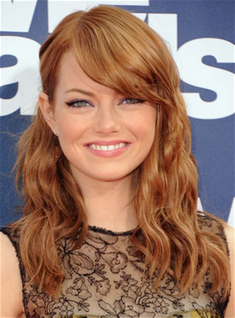 emma stone face shape emma stone s red curly hairstyle with bangs