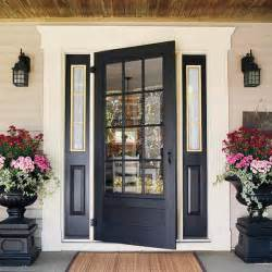 Dramatic hardware and paned sidelights for a craftsman style home