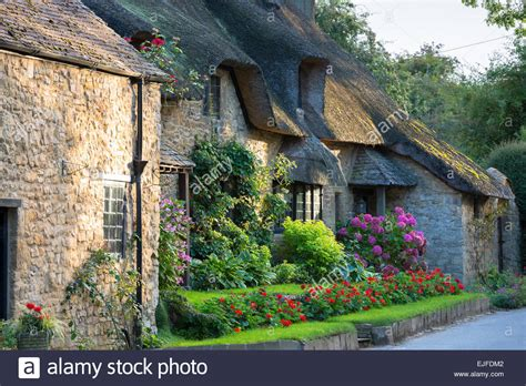 quaint town stock photos quaint town stock images alamy quaint attractive traditional thatched country cottage at