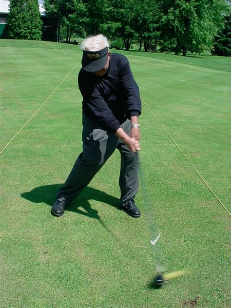 golf swing impact position moe norman golf the single plane golf swing of moe norman