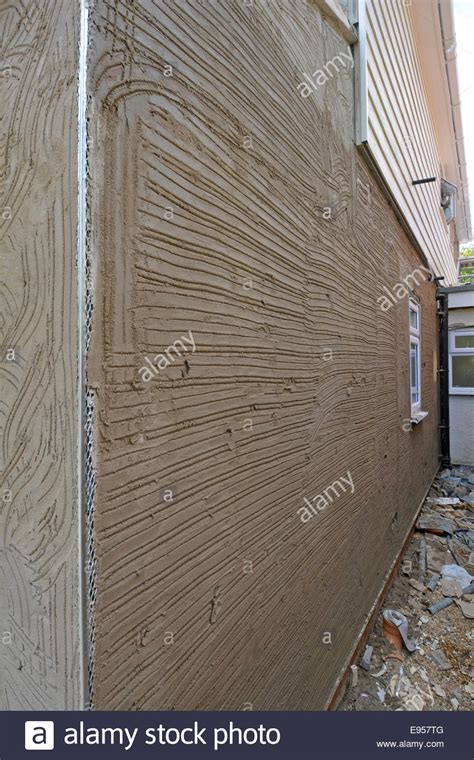 angle for rendering cement sand rendering scratch coat on house wall showing