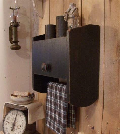 primitive bathroom cabinet towel rack toilet paper storage