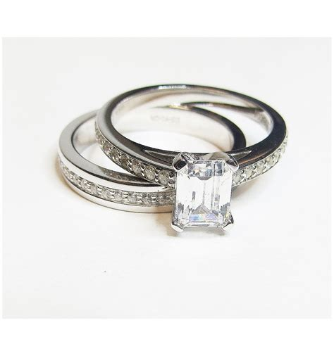 square cut engagement ring in white gold