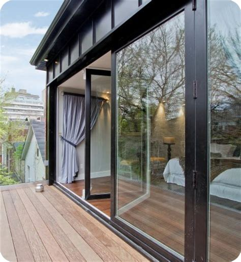 floor to ceiling windows glass doors tiny house