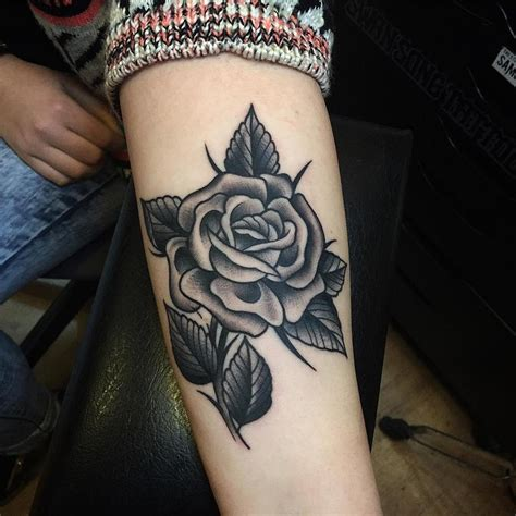 rose black tattoo black on forearm by samuele briganti
