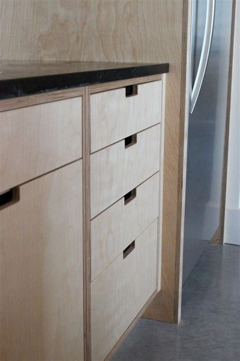 Plywood Cabinet Doors The Forest House Plywood Kitchen Cabinet Cutouts Remodelista Kitchens Pinterest