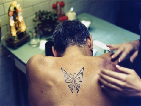 george clooney tribal tattoo george clooney butterfly see photos of the iconic