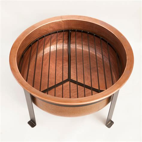 handcrafted copper pit grill table the green