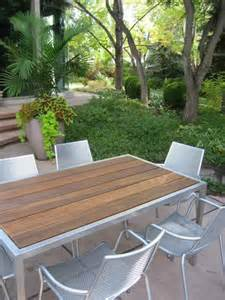 Lovely Large Dining Table In Small Space #4: Modern-cement-planter-and-round-boxwood.jpg