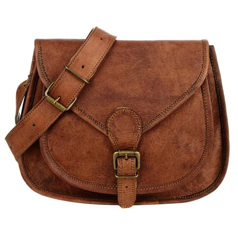 Saddle Leather curved brown leather saddle bag by paper high notonthehighstreet