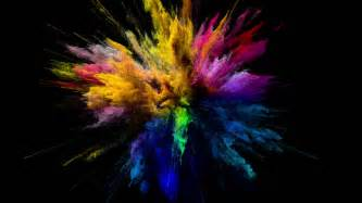 color explosion cg animation of color powder explosion on black background