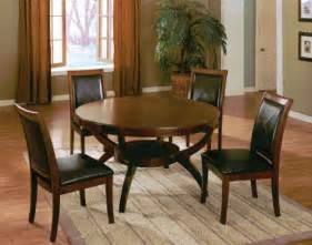 Wooden round dining table and 4 high back side chair with bycast