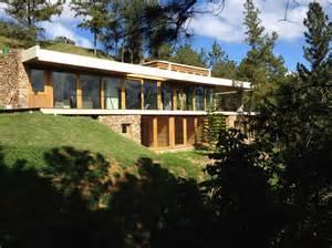 homes built into hillside grass roofed home built into slope uses hillside for cooling modern house designs