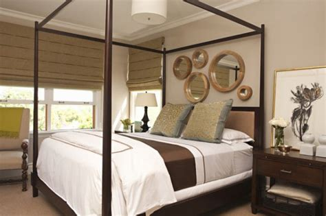 i like the picture collage above the bed pottery barn mirror collages ideas and inspiration