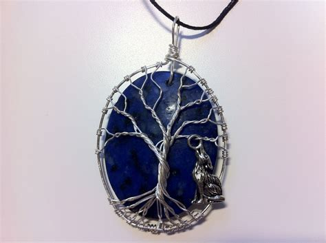 wire wrapped stone tree of life with wolf by pattyofurniture